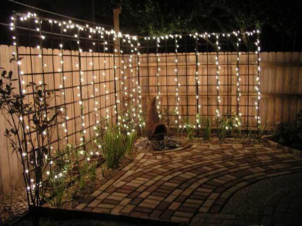 -d-eclairage-exterieur-pour-jardin-pas-cher 27-guirlande-autour-treille