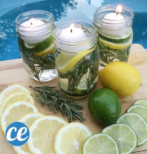 3 bougies anti-moustiques faites maison dans des bocaux en verre.