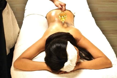 massage avec huile de ricin contre courbatures