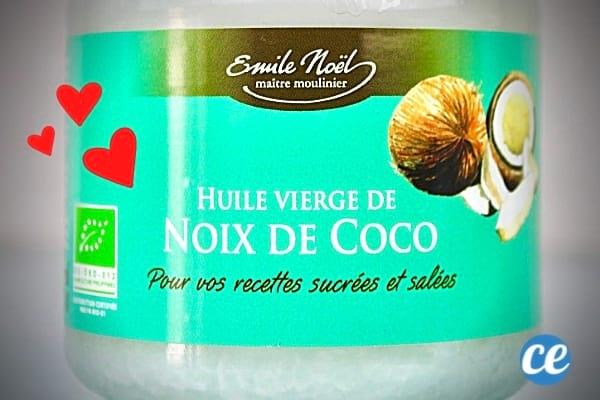 Un flacon d'huile de coco vert clair avec des coeur pour mettre sur le visage