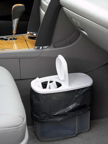 une boite de céréales en plastique vide fera une poubelle de voiture