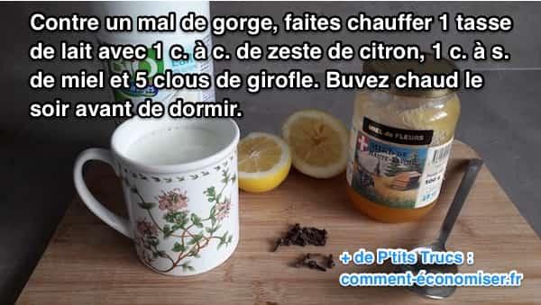 une tasse de lait avec des clous de girofle, du miel, du citron pour soigner un mal de groge